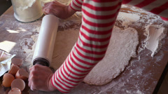Woman kneading dough with rolling pin HD Stock Footage