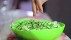 Making salad - adding flax seed, olive oil, shoyo Stock Footage
