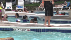 Swimmimg pool with families Stock Footage