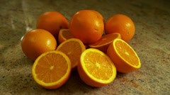 Whole & Sliced Oranges on Counter, Close Up - stock footage