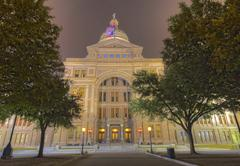 The front façade of the texas capitol building at night Stock Photos