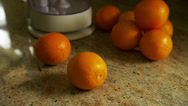 Stock Video Footage of Man Slices Orange on Counter