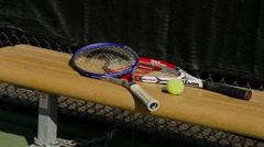 Tennis Rackets & Balls on Bench Stock Footage