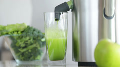 Juicer making green broccoli vegetable juice Stock Footage