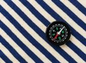 Stock Photo of compass on a sailor shirt