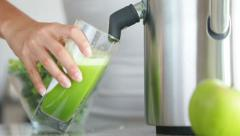 Juicing machine making broccoli vegetable juice Stock Footage