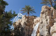 Stock Photo of waterfall and palm tree in dubai