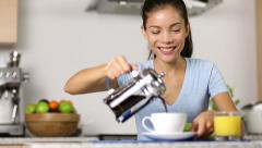 Woman making french press coffee at breakfast Stock Footage