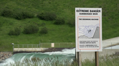 Irrigation Dam Spillway with danger sign Stock Footage