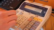 Stock Video Footage of Man Using a Calculator