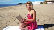 Stock Video Footage of Girl on Beach in Sundress Reading