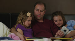 Father Reading to Daughters Stock Footage