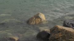 Waves slash over rocky shore Stock Footage