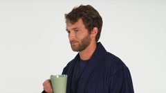 Young Man in Robe Drinks Morning Coffee Stock Footage