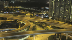 Time lapse of a busy Hong Kong harbour freeway at night Stock Footage