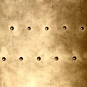 Gold metal plate or armour texture with rivets Stock Photos