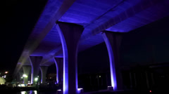 Beautiful blue illuminated bridge in Miami by night - stock footage