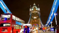 Traffic crosses tower bridge in London Stock Footage
