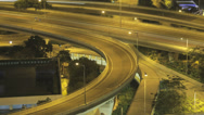 Stock Video Footage of Time lapse panning across a busy Hong Kong freeway at night