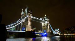 tower bridge in london wide night view of towers and thames river water refle - stock footage