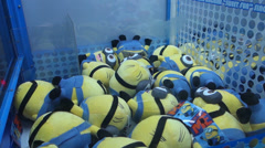 Grasp Minions in a game machine Stock Footage