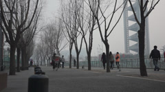 Hawker of sugarcoated haws cycling in a  hazy winter day, Beijing Stock Footage