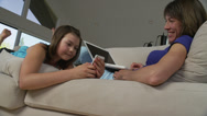 Daughter Shows Mother Her Smartphone Stock Footage
