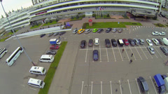 People walk by car parking near hotel at autumn day in Izmailovo Stock Footage