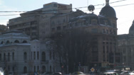 Stock Video Footage of Commercial Bank Of Romania With Traffic Pan-Shot