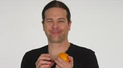 Creepy Man Peels & Eats Orange Stock Footage