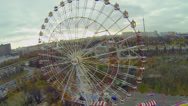 Stock Video Footage of Ferris wheel spins near roller-coaster amusement