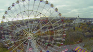 Stock Video Footage of Ferris wheel spins near roller-coaster amusement at park