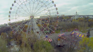 Stock Video Footage of Ferris wheel circling near roller-coaster amusement at park