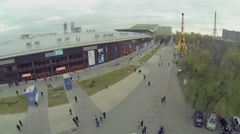 Citizens walk near pavilion Mosexpo at Russian Exhibition Center Stock Footage