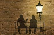 Stock Illustration of two silhouettes on a bench (coffee story art on the wall series)