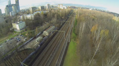 Cityscape with railway tracks at autumn sunny day in Moscow Stock Footage