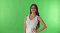 Cheerful girl standing on green background smiling at camera and showing ok  Stock Footage