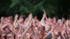 People raise their hands up and applaud at a concert Stock Footage