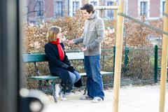 couple in their 20s, outside - stock photo
