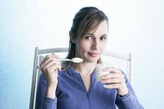 Woman, dairy product Stock Photos