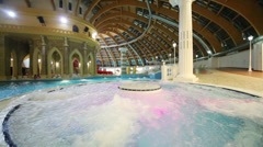 Jacuzzi with purple backlight at waterpark Caribia at evening Stock Footage