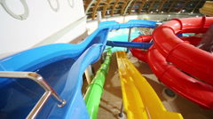 Interweaving of colorful water slides at the indoor waterpark Stock Footage