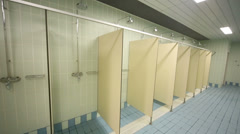 Large public shower room with several of shower enclosures Stock Footage