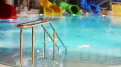 Metal railings in the pool and water slides at the water park Stock Footage