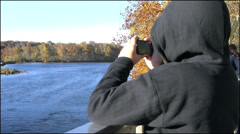 Maryland Boy in hood photographs Patomic Riiver 4k Stock Footage