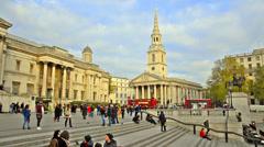People visit trafalgar square in London Stock Footage