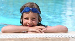 Girl wears swimming goggles and goes under the water Stock Footage
