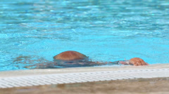 Little boy in red trunks gets out of the hotels pool Stock Footage