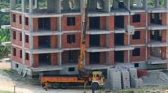 Truck with crane lift materials on top floor Stock Footage
