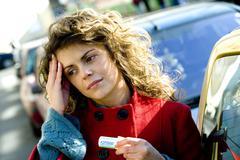 Woman with aspirin Stock Photos